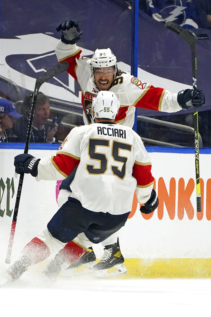 FILE - Florida Panthers left wing Ryan Lomberg (94) celebrates his goal against the Tampa Bay Lightning with center Noel Acciari (55) during overtime in Game 3 of an NHL hockey Stanley Cup first-round playoff series in Tampa, Fla., in this Thursday, May 20, 2021, file photo. A pandemic postseason outside a bubble has led to some thrilling hockey after an exhausting, condensed 56-game grind. (AP Photo/Chris O'Meara, File)