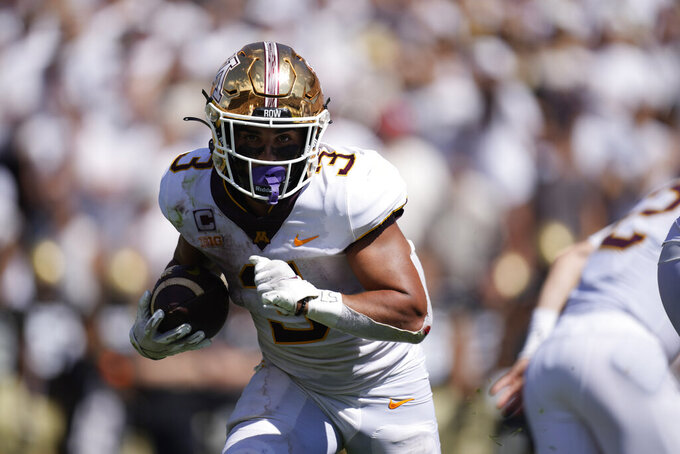 Minnesota running back Treyson Potts runs for a touchdown against Colorado in the second half of an NCAA college football game Saturday, Sept. 18, 2021, in Boulder, Colo. Minnesota won 30-0. (AP Photo/David Zalubowski)