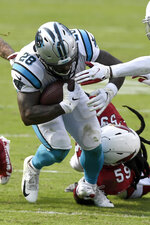Carolina Panthers running back Mike Davis is tackled by Arizona Cardinals outside linebacker De'Vondre Campbell during the second half of an NFL football game Sunday, Oct. 4, 2020, in Charlotte, N.C. (AP Photo/Mike McCarn)
