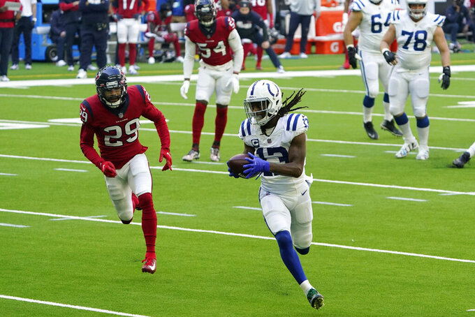 Indianapolis Colts wide receiver T.Y. Hilton (13) is perused by Houston Texans cornerback Phillip Gaines (29) after a catch during the first half of an NFL football game Sunday, Dec. 6, 2020, in Houston. (AP Photo/David J. Phillip)