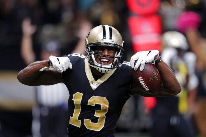 New Orleans Saints wide receiver Michael Thomas (13) celebrates his touchdown reception in the second half of an NFL football game against the Tampa Bay Buccaneers in New Orleans, Sunday, Oct. 6, 2019. (AP Photo/Bill Feig)