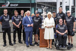 Britain's Prince Charles, fifth left, and his wife Camilla, center, pose for a photo with the America's Cup and members of Team New Zealand during a public walk at Viaduct Harbour in Auckland during their royal visit to New Zealand, Tuesday, Nov. 19, 2019. The visit is part of a week-long tour of the country which also takes in Christchurch and Kaikoura. (David Rowland/Pool Photo via AP)