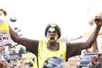 A supporter of Ugandan President Yoweri Kaguta Museveni celebrates, in Kampala, Uganda, Saturday Jan. 16, 2021, after their candidate was declared winner of the presidential elections.  Uganda's electoral commission says longtime President Yoweri Museveni has won a sixth term, while top opposition challenger Bobi Wine alleges rigging and officials struggle to explain how polling results were compiled amid an internet blackout. In a generational clash widely watched across the African continent, the young singer-turned-lawmaker Wine posed arguably the greatest challenge yet to Museveni. (AP Photo/Nicholas Bamulanzeki)