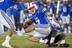 SMU quarterback Shane Buechele (7) is tackled by Cincinnati linebacker Jarrell White (8) for a loss during the first half of an NCAA college football game Saturday, Oct. 24, 2020, in Dallas. (AP Photo/Jeffrey McWhorter)