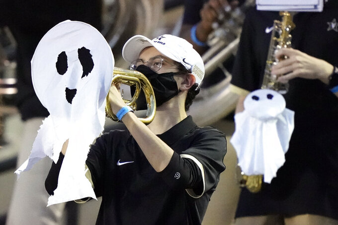 Vanderbilt band members perform with Halloween ghost costumes on their instruments during the second half of an NCAA college football game between Vanderbilt and Mississippi Saturday, Oct. 31, 2020, in Nashville, Tenn. (AP Photo/Mark Humphrey)