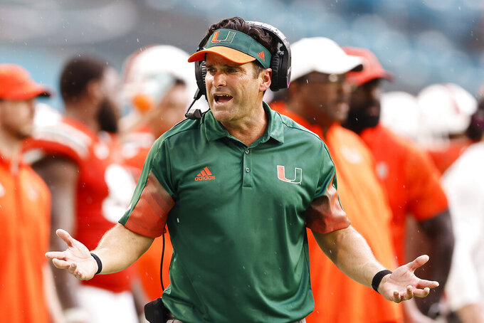 Miami head coach Manny Diaz argues a penalty call with a referee during the fourth quarter of an NCAA college football game against Michigan State, Saturday, Sept. 18, 2021, in Miami Gardens, Fla. (AP Photo/Michael Reaves)