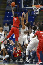 Rutgers Akwasi Yeboah (1) puts up a left handed shot over Penn State's Lamar Stevens (11) during the first half of an NCAA college basketball game, Wednesday, Feb. 26, 2020, in State College, Pa. (AP Photo/Gary M. Baranec)