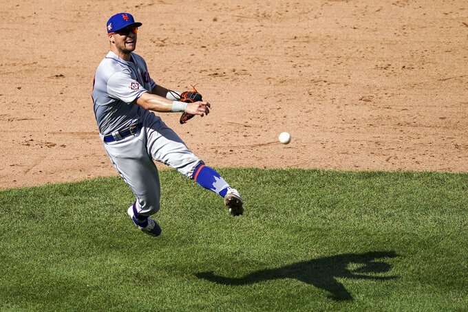 FILE - In this Aug. 29, 2020, file photo, New York Mets third baseman J.D. Davis (28) throws out New York Yankees' Aaron Hicks at first after fielding a ground ball during the eighth inning of a baseball game in New York. Davis and the Mets argued the first of 13 scheduled salary arbitration cases this month. The third baseman and outfielder asked for a raise from $592,463 to $2,475,000 during Tuesday's hearing before Gil Vernon, Mark Burstein and Jeanne Vonhof. The Mets argued for $2.1 million. Davis is eligible for arbitration for the first time. (AP Photo/John Minchillo, File)