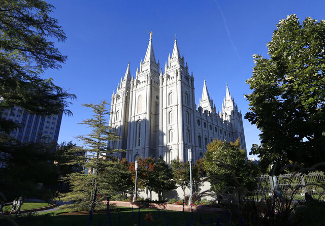 FILE - In this Oct. 5, 2019, file photo, The Salt Lake Temple stands at Temple Square in Salt Lake City. The Church of Jesus Christ of Latter-day Saints added new language to the faith's handbook Friday, Dec. 18, 2020, imploring members to root out prejudice and racism, adding significance and permanence to recent comments by top leaders on one of the most sensitive topics in the church's history. (AP Photo/Rick Bowmer, File)