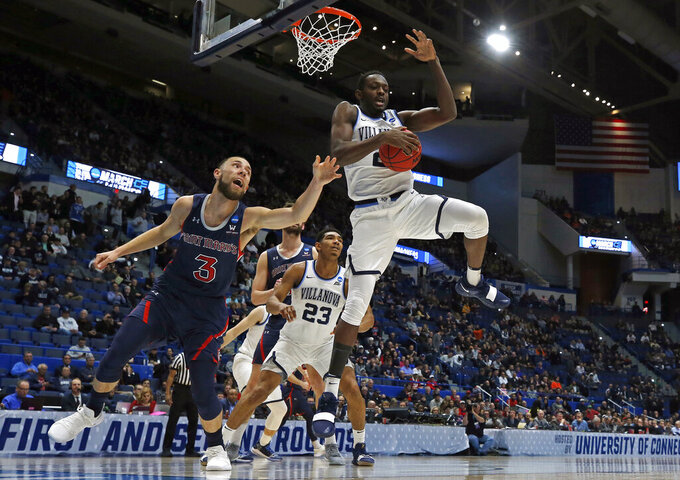Villanova's Dhamir Cosby-Roundtree (21) blocks a shot and grabs the ball from St. Mary's Jordan Ford (3) during the first half of a first round men's college basketball game in the NCAA Tournament, Thursday, March 21, 2019, in Hartford, Conn. (AP Photo/Elise Amendola)