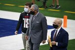Arthur Blank, center, owner of the Atlanta Falcons walks along the sideline before an NFL football game against the Dallas Cowboys in Arlington, Texas, Sunday, Sept. 20, 2020. (AP Photo/Michael Ainsworth)