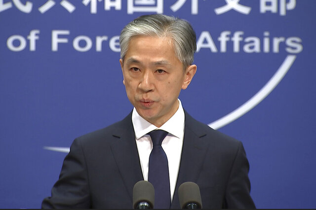 Chinese foreign ministry spokesman, Wang Wenbin, speaks during a routine press conference where he congratulated U.S. president-elect Joe Biden at the foreign ministry in Beijing on Friday, Nov. 13, 2020. China on Friday became one of the last major countries to congratulate Joe Biden on being elected U.S. president. (AP Photo/Liu Zheng)