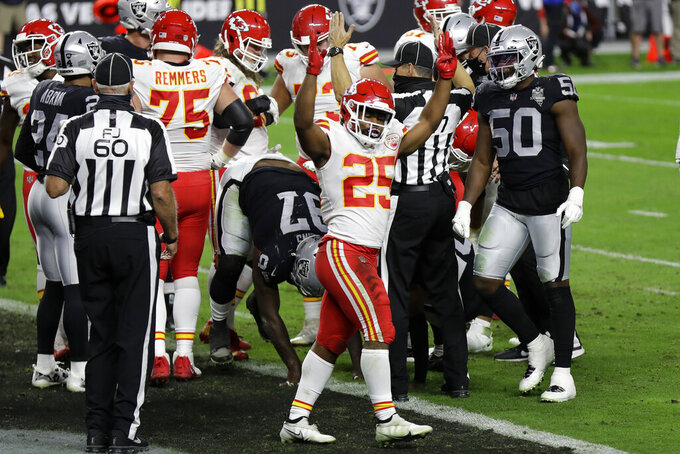 Kansas City Chiefs running back Clyde Edwards-Helaire (25) celebrates after scoring a touchdown against the Las Vegas Raiders during the first half of an NFL football game, Sunday, Nov. 22, 2020, in Las Vegas. (AP Photo/Isaac Brekken)