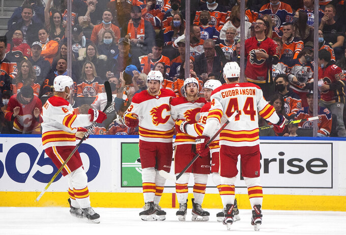 Calgary Flames celebrate a goal against the Edmonton Oilers' during the second period of an NHL hockey game Saturday, Oct. 16, 2021, in Edmonton, Alberta. (Jason Franson/The Canadian Press via AP)
