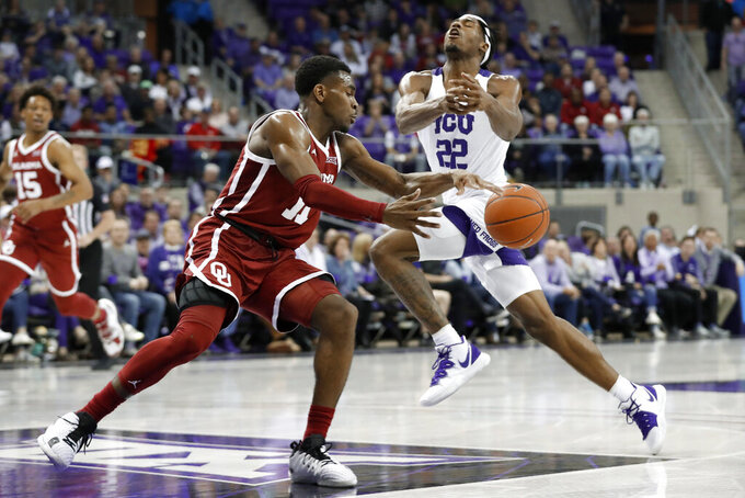 Oklahoma guard De'Vion Harmon (11) breaks up a drive to the basket by TCU guard RJ Nembhard (22) in the second half of an NCAA college basketball game in Fort Worth, Texas, Saturday, March 7, 2020. (AP Photo/Tony Gutierrez)