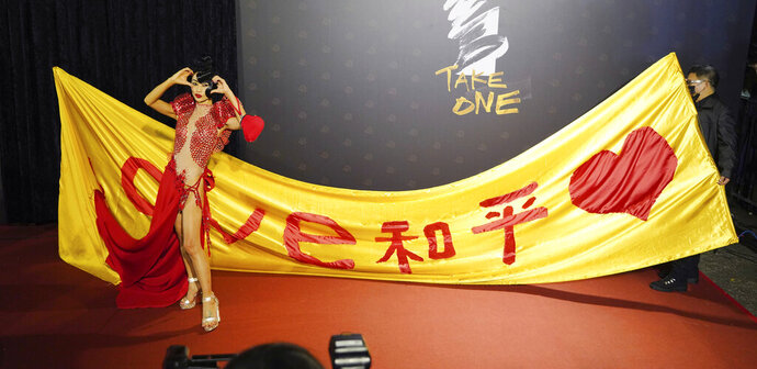 Chinese-American actress Bai Ling poses with her slogan