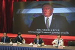 Xu Guixiang, a spokesperson for the Xinjiang northwestern region's government, second from right, and attendees sit near a screen showing former U.S. Secretary of State Mike Pompeo, during a press conference related to Xinjiang issues in Beijing, Tuesday, May 25, 2021. China on Tuesday denounced a people's tribunal planned for the UK over allegations of genocide being committed against Uyghurs and other Turkic Muslim people in the Xinjiang region. (AP Photo/Andy Wong)