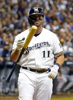 Milwaukee Brewers' Mike Moustakas flips his bat after striking out during the third inning of a baseball game against the San Diego Padres Wednesday, Sept. 18, 2019, in Milwaukee. (AP Photo/Morry Gash)