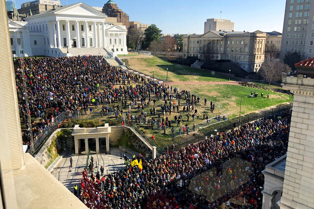 Demonstrators are seen during a pro-gun rally, Monday, Jan. 20, 2020, in Richmond, Va. Thousands of pro-gun supporters are expected at the rally to oppose gun control legislation like universal background checks that are being pushed by the newly elected Democratic legislature. (AP Photo/Sarah Rankin)