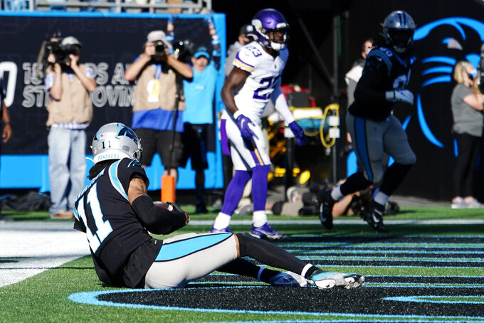 Carolina Panthers wide receiver Robby Anderson (11) makes a touchdown catch against the Minnesota Vikings during the second half of an NFL football game, Sunday, Oct. 17, 2021, in Charlotte, N.C. (AP Photo/Jacob Kupferman)