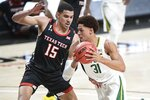 Baylor's MaCio Teague (31) drive the ball against Texas Tech's Kevin McCuller (15) during the first half of an NCAA college basketball game in Lubbock, Texas, Saturday, Jan. 16, 2021. (AP Photo/Justin Rex)