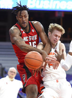 North Carolina State forward Manny Bates (15) and Syracuse forward Marek Dolezaj (21) fight for the ball during an NCAA college basketball game Sunday, Jan. 31, 2021,  in Syracuse, N.Y. (Dennis Nett/The Post-Standard via AP)