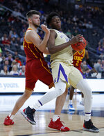Washington's Noah Dickerson, right, drives into Southern California's Nick Rakocevic, left, during the first half of an NCAA college basketball game in the quarterfinal round of the Pac-12 men's tournament Thursday, March 14, 2019, in Las Vegas. (AP Photo/John Locher)