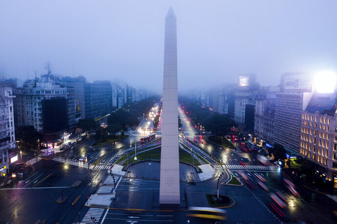 Cars drive on the 9 de Julio Ave, near the Obelisk monument in Buenos Aires, Argentina, early Monday morning, June 17, 2019. As lights turned back on across Argentina, Uruguay and Paraguay after a massive blackout that hit tens of millions people, authorities were still largely in the dark about what caused the collapse of the interconnected grid and were tallying the damage from the unforeseen disaster. (AP Photo/Tomas F. Cuesta)