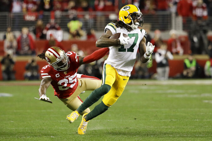 Green Bay Packers wide receiver Davante Adams breaks away form San Francisco 49ers cornerback Richard Sherman during the second half of the NFL NFC Championship football game Sunday, Jan. 19, 2020, in Santa Clara, Calif. (AP Photo/Marcio Jose Sanchez)