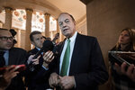 Sen. Richard Shelby, R-Ala., chair of the Senate Appropriations Committee, pauses for reporters as he and other senior bipartisan House and Senate negotiators try to negotiate a border security compromise in hope of avoiding another government shutdown, at the Capitol in in Washington, Monday, Feb. 11, 2019. (AP Photo/J. Scott Applewhite)