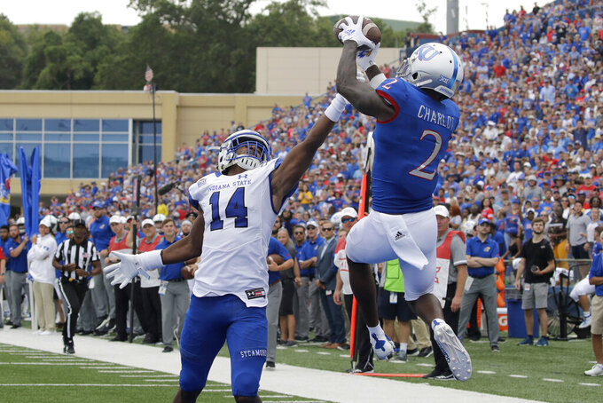 Kansas wide receiver Daylon Charlot (2) catches a pass in the end zone under pressure from Indiana State defensive back Mekhi Ware (14) for a touchdown during the second half of an NCAA college football game Saturday, Aug. 31, 2019, in Lawrence, Kan. Kansas won 24-17. (AP Photo/Charlie Riedel)