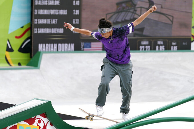 Mariah Duran, of the United States, competes during an Olympic qualifying skateboard event at Lauridsen Skatepark, Saturday, May 22, 2021, in Des Moines, Iowa. The questions under the magnifying glass at this week's Dew Tour — one of the last major qualifying events for the games in Tokyo in July — is whether the Olympics is ready for skateboarding and, more tellingly, whether skateboarding is ready for the Olympics. (AP Photo/Charlie Neibergall)