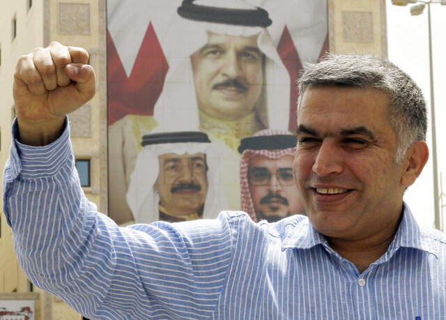 FILE - In this May 28, 2012 file photo, human rights activist Nabeel Rajab gestures as he leaves a police station in Manama, Bahrain. Rajab, a prominent human rights activist in Bahrain has been released amid the ongoing coronavirus pandemic. His family says Nabeel Rajab left prison Tuesday and will serve the rest of his sentence from home. Rajab had been sentenced to five years in prison over his tweets alleging abuse at Bahrain's Jaw prison and criticizing civilian casualties in the Yemen war waged by a Saudi-led coalition. (AP Photo/Hasan Jamali, File)