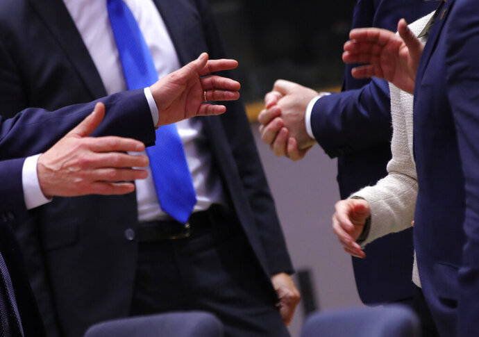 European Union leaders engage in discussion during a round table meeting at an EU summit in Brussels, Thursday, Feb. 20, 2020. After almost two years of sparring, the EU will be discussing the bloc's budget to work out Europe's spending plans for the next seven years. (AP Photo/Olivier Matthys)