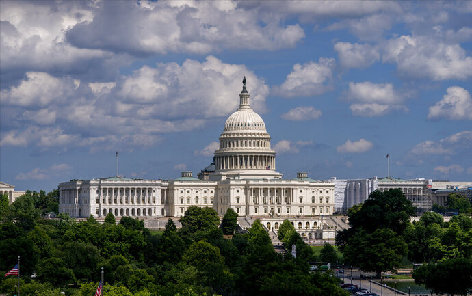 In this June 20, 2019 photo, the Capitol is seen from the roof of the Canadian Embassy in Washington. Health care is on the agenda for Congress when lawmakers return, and it's not another battle over the Obama-era Affordable Care Act. Instead of dealing with the uninsured, lawmakers are trying to bring down costs for people who already have coverage.  (AP Photo/J. Scott Applewhite)