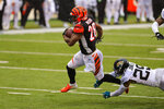 Cincinnati Bengals running back Joe Mixon (28) runs for a touchdown in front of Jacksonville Jaguars strong safety Josh Jones (29) in the second half of an NFL football game in Cincinnati, Sunday, Oct. 4, 2020. (AP Photo/Aaron Doster)