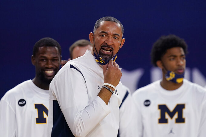 Michigan head coach Juwan Howard watches from the sideline during the first half of an NCAA college basketball game against Iowa, Thursday, Feb. 25, 2021, in Ann Arbor, Mich. (AP Photo/Carlos Osorio)