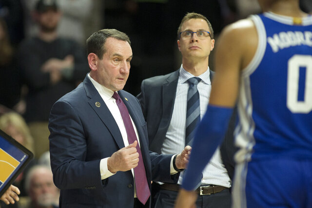 Duke head coach Mike Krzyzewski calls over his team at the end of regulation against Wake Forest during an NCAA college basketball game Tuesday, Feb. 25, 2020, in Winston-Salem, N.C. Wake Forest wins in double overtime 113-101. (AP Photo/Lynn Hey)