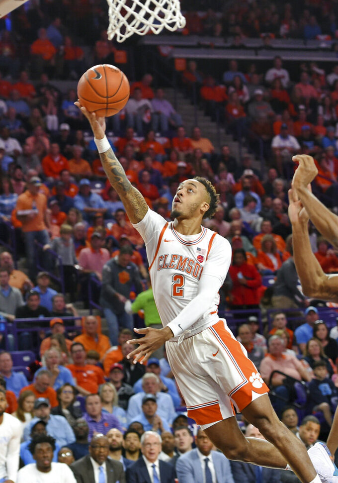 Clemson's Marcquise Reed drives to the basket for a layup during the first half of the team's NCAA college basketball game against North Carolina on Saturday, March 2, 2019, in Clemson, S.C. (AP Photo/Richard Shiro)