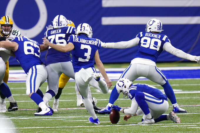 Indianapolis Colts kicker Rodrigo Blankenship (3) boots the winning field goal out of the hold of Rigoberto Sanchez (8) during overtime of an NFL football game against the Green Bay Packers, Sunday, Nov. 22, 2020, in Indianapolis. (AP Photo/AJ Mast)