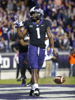 TCU wide receiver Jalen Reagor (1) gestures after scoring a second-quarter touchdown during an NCAA college football game against Oklahoma in Fort Worth, Texas, Saturday, Nov. 24, 2018. (Tom Fox/The Dallas Morning News via AP)