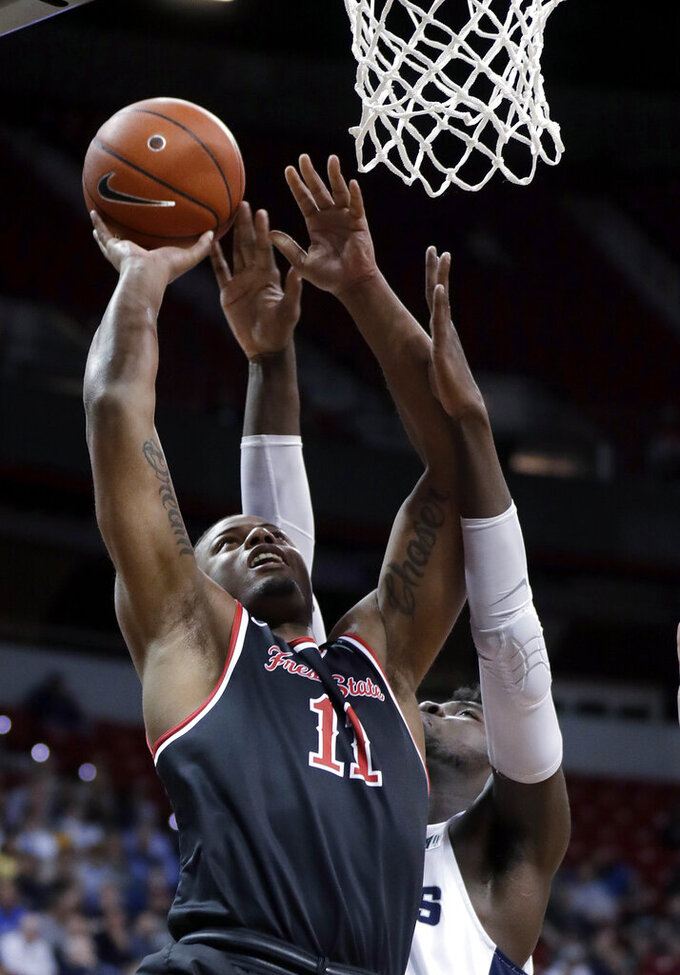 Fresno State's Christian Gray shoots during the second half of the team's NCAA college basketball game against Utah State in the Mountain West Conference men's tournament Friday, March 15, 2019, in Las Vegas. (AP Photo/Isaac Brekken)