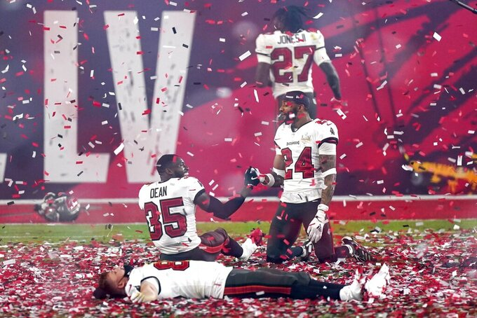 Tampa Bay Buccaneers players celebrate after the NFL Super Bowl 55 football game against the Kansas City Chiefs, Sunday, Feb. 7, 2021, in Tampa, Fla. The Buccaneers defeated the Chiefs 31-9 to win the Super Bowl. (AP Photo/Mark Humphrey)
