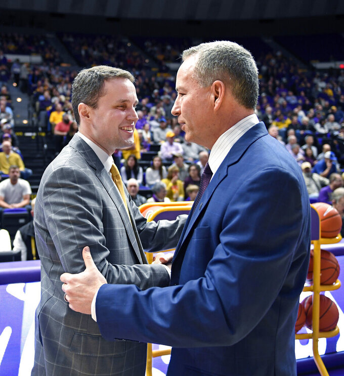 LSU head coach Will Wade, left, and Texas A&M head coach Billy Kennedy meet at mid court before the start of the first half of an NCAA college basketball game, Tuesday, Feb. 26, 2019, in Baton Rouge, La. (AP Photo/Bill Feig)