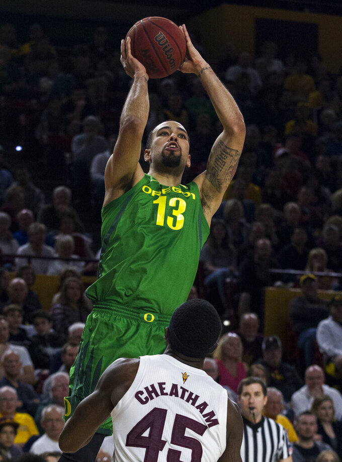 Oregon's Paul White (13) puts up a shot against Arizona State's Zylan Cheatham (45) during the first half of an NCAA college basketball game Saturday, Jan. 19, 2019, in Tempe, Ariz. (AP Photo/Darryl Webb)