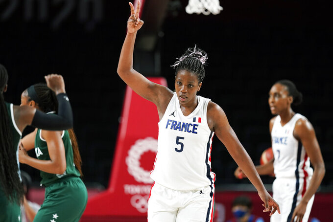 France's Endene Miyem (5) celebrates after making a basket during a women's basketball preliminary round game against Nigeria at the 2020 Summer Olympics, Friday, July 30, 2021, in Saitama, Japan. (AP Photo/Charlie Neibergall)