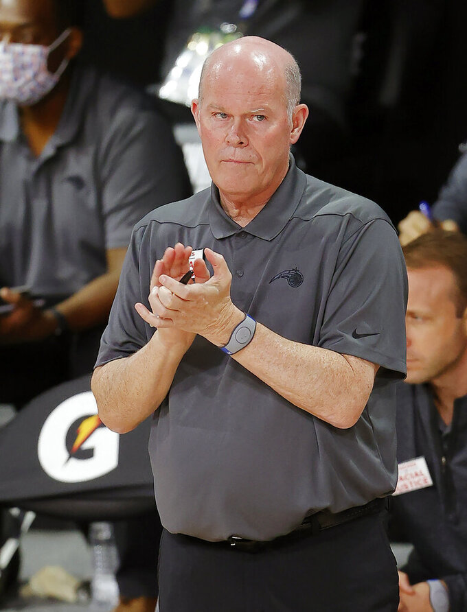 FILE - In this Tuesday, Aug. 11, 2020, file photo, Orlando Magic head coach Steve Clifford claps during the first half of an NBA basketball game against the Brooklyn Nets, in Lake Buena Vista, Fla. The Magic and Milwaukee Bucks open the Eastern Conference playoffs Tuesday, Aug. 18, 2020, at Disney's Wide World of Sports. (Mike Ehrmann/Pool Photo via AP)