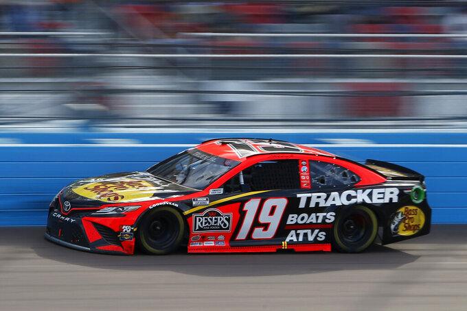 Martin Truex Jr races through Turn 4 during a NASCAR Cup Series auto race at Phoenix Raceway, Sunday, March 14, 2021, in Avondale, Ariz. (AP Photo/Ralph Freso)