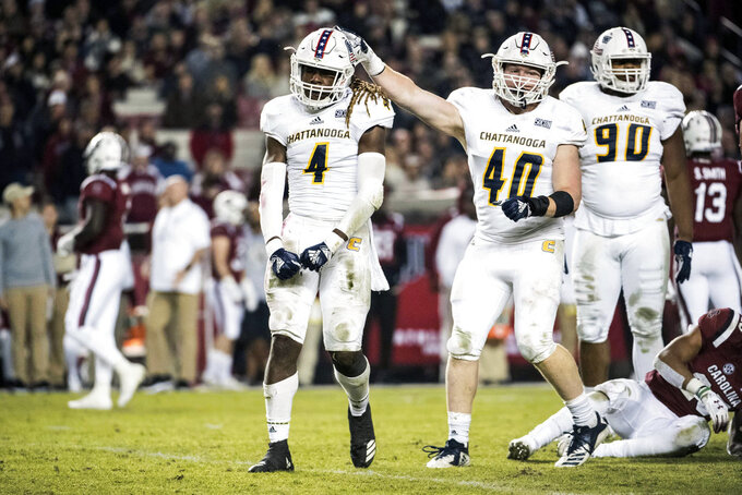 Chattanooga linebacker Tavon Lawson (4) and Marshall Cooper (40) celebrate a defensive play during the first half of an NCAA college football game against South Carolina, Saturday, Nov. 17, 2018, in Columbia, S.C. (AP Photo/Sean Rayford)