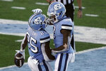 North Carolina running back Javonte Williams (25) and wide receiver Dyami Brown (2) react following Williams' touchdown against Wake Forest during the second half of an NCAA college football game in Chapel Hill, N.C., Saturday, Nov. 14, 2020. (AP Photo/Gerry Broome)